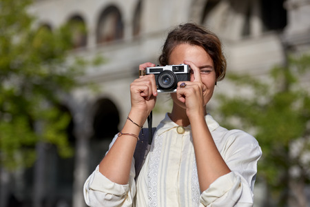 Woman taking pictures while traveling on vacation Banco de Imagens