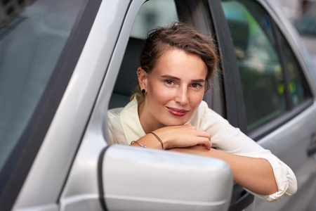 Woman with car in city portrait Banco de Imagens