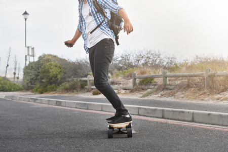 modern commute on electric skateboard in city urban transportation battery powered vehicle Stok Fotoğraf