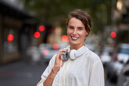 Woman with headphones in city portrait Stok Fotoğraf