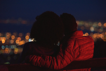 Anonymous couple on a romantic date, looking at city lights young romance Stok Fotoğraf