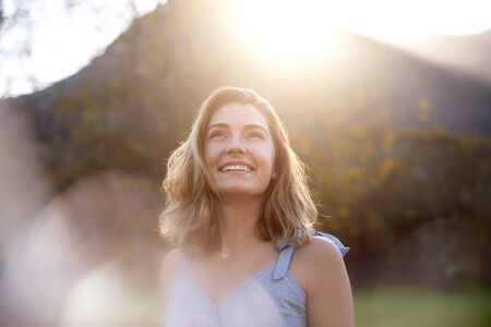 happy sunrise woman with beautiful smile full of optimism Stok Fotoğraf