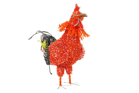 red hen: Thre quarter stance of African wire and beadwork Hen on white background