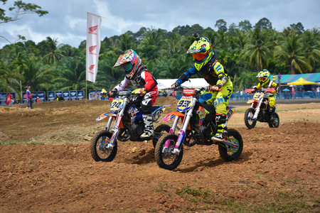grand child: Chumphon, Thailand - August 28, 2016 : Some riders racing at Child Session of Moto Grand Prix of Tungka, on August 28, 2016 in Chumphon, Thailand. Editorial