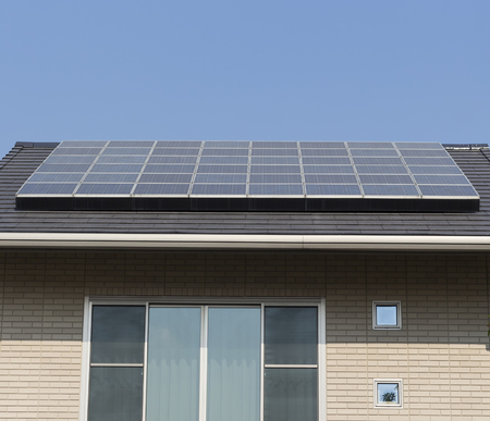 pollution free: Solar panel installion on a roof house on blue sky Stock Photo