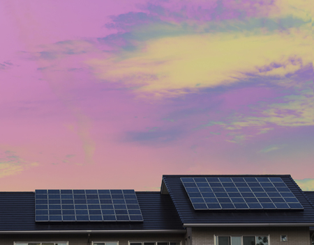 Solar panels on roof of a house with surreal color background