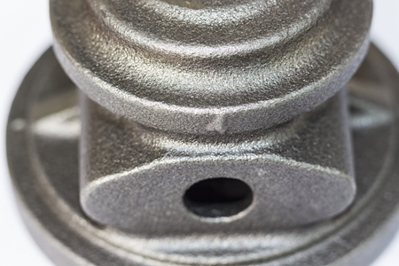 raw material for bearing housing of Turbo Charger made by iron casting parts for automotive with white background;Selective focus 스톡 콘텐츠