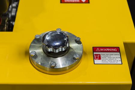 Hydraulic oil reservoir tank cap ; selective focus