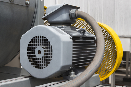 motor of air blower with yellow safety guard