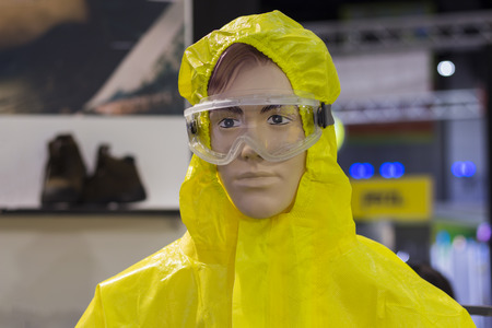 Chemical protection suit ; yellot hazmat Stock Photo