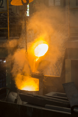 iron metal poured in to ladle ; foundry factory