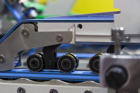 detail of a folder gluer machine for carton box