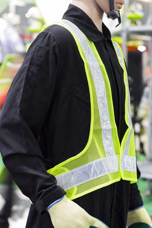 a yellow mesh safety vest with reflective tape. Stock Photo