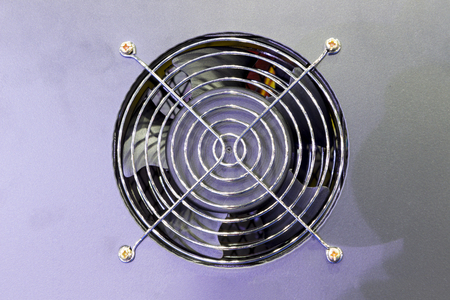 Small Cooling fan in an  industrial printer ; to  control temperature of machine