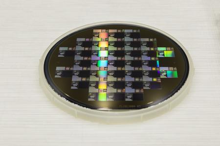 a Semiconductor wafer disk ; close up Фото со стока