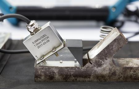 ultrasonic probe testing welding steel ; close up Stock Photo