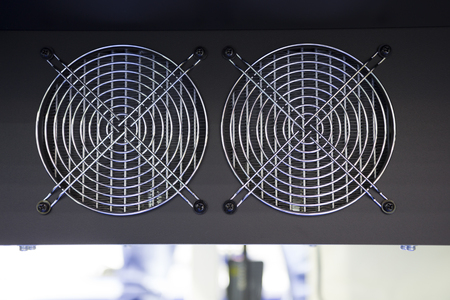 Small Cooling fan in an  industrial printer ; to  control temperature of machine Reklamní fotografie - 91536340