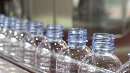 PET water bottle in conveyor of labelling machine Banco de Imagens - 96852766