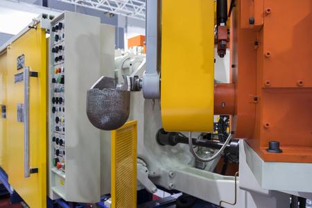 Detail of aluminum high pressure die casting machine ; ladle Stock Photo - 100715885