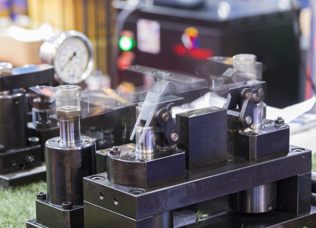 hydraulic clamping jig for machining process ; Blurred from moving component Stock Photo