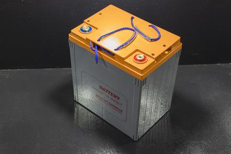 Close up industrial battery . shown in shelf ; golf cart battery