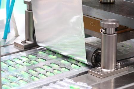 medicine capsules packing machine ; process 免版税图像