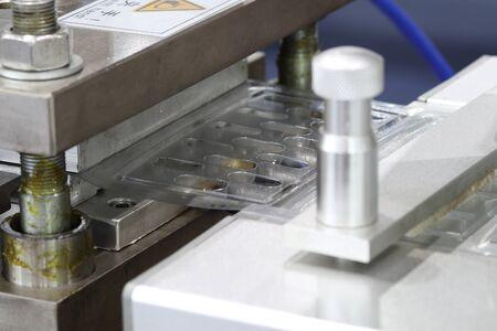 medicine capsules packing machine ; process Reklamní fotografie