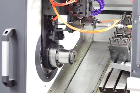 inside CNC lathe machine ; without workload ; door open