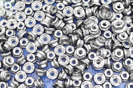 small bolts and nuts by manufacturing process ; tapping Reklamní fotografie