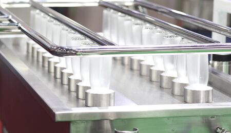 Glass  bottles in cleaning process  spraying by high pressure water ; automated machine