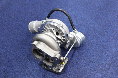 Turbo charger component parts for diesel engine ; made from iron , aluminium , steel casting and machining process ; industrial background