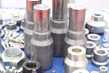 small bolts and nuts by manufacturing process ; tapping ; metallurgy engineering industrial background