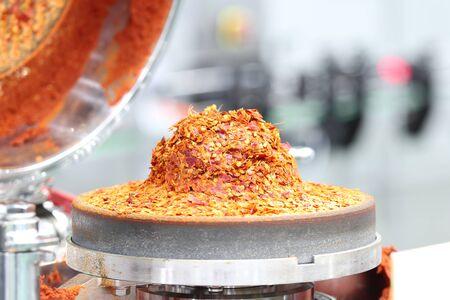 Fine red ground chili in chili paste grinder machine