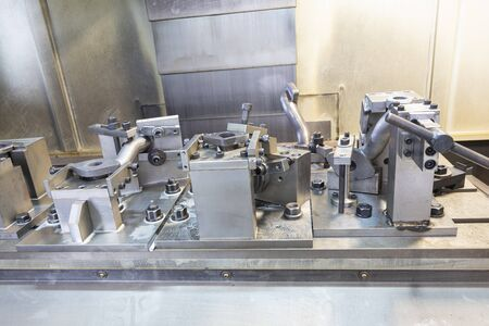 iron casting pipes were clamped on jig , ready for machining process by CNC machine