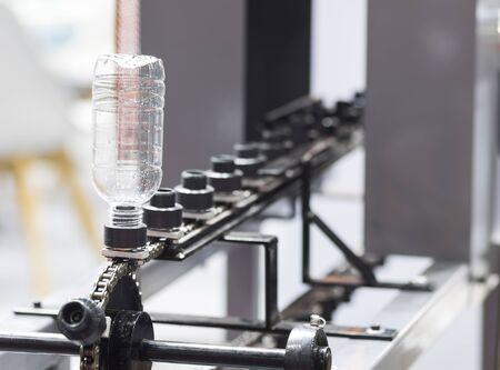 A plastic bottle in shrink label machine ; engineering industrial equipment
