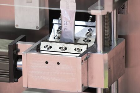 Dry Food automatic packing machine using aluminium foil sheet ;industrial equipment background Banque d'images