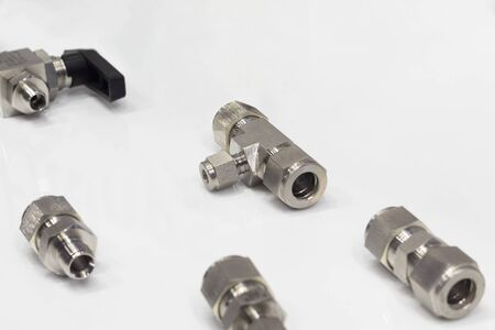 Industrial metal pipe connectors, adapters ; engineering background ; close up Stock Photo