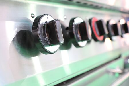 Close up black switch of Kitchen burning gas cooker ; knob