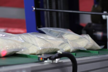 Rice packing in plastic bag on conveyor line