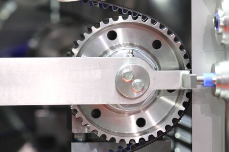 Black timing belt that synchronizes the rotation of gear drum in NUGGETS MEAT FORMING AUTOMATIC machine ; industrial engineering  background Banque d'images