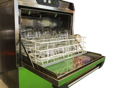 Open dishwasher with clean glass, cups, plates and dishes, selective focus  Banque d'images