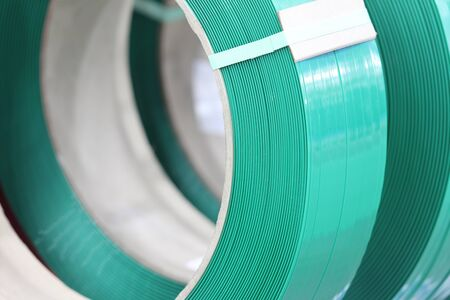 Green PP band for packaging and fastening of carton box ; Business industrial background