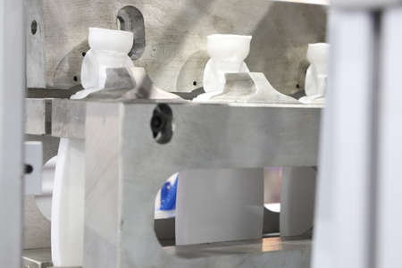 Extrusion Blow Moulding Process for making white plastic bottle