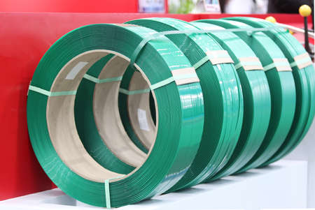 Green PP band for packaging and fastening of carton box ; Business industrial background Reklamní fotografie