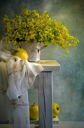 still life with bouquet and yellow apples