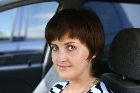 Portrait of the young woman in the automobile photo