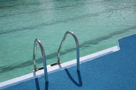 chromeplated: Metal chromeplated ladder in open pool