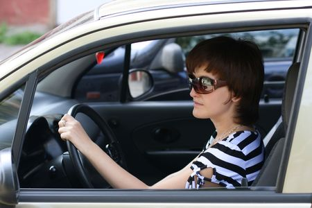 Portrait of the girl managing the automobile