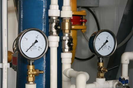 Two manometers, valve and pipes in boiler-house
