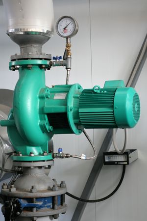 The pump established on the vertical pipeline in boiler-house